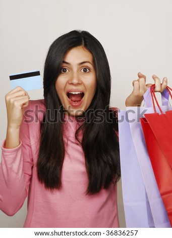 woman with shopping bags.  Woman with credit card.  Woman shopping.  Young woman shopping.  Woman credit card.