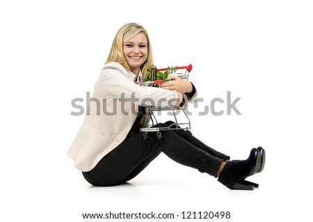 Woman with shopping cart isolated in white