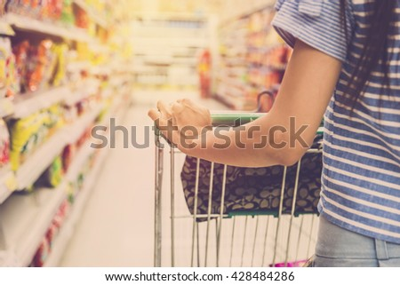 woman with shopping cart....