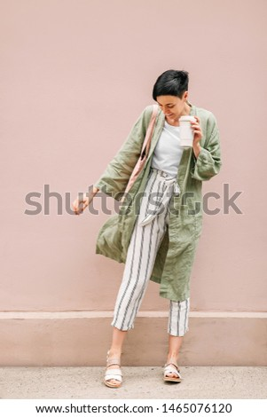 Woman with short hair holding reusable coffee cup and eco bag enjoying morning. Eco friendly concept. #1465076120