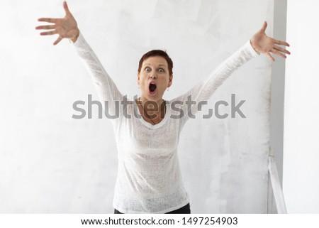 Woman with short hair raising hands #1497254903