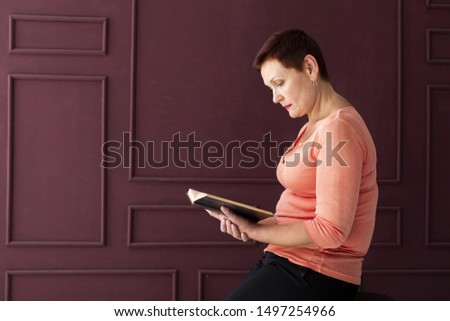 Woman with short hair reading a magazine #1497254966