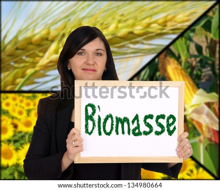 Woman with sign and the german word biomass / biomass