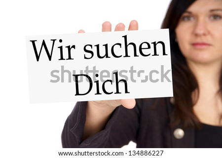 Woman with sign and the german words We are looking for you / We are looking for you