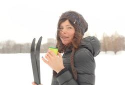 woman with skies close up winter snow park portrait
