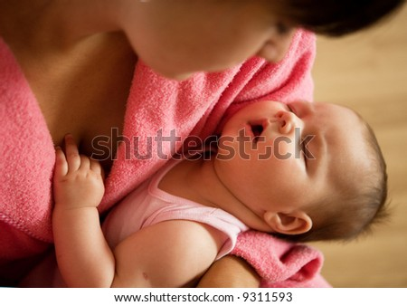 Woman with sleeping  baby