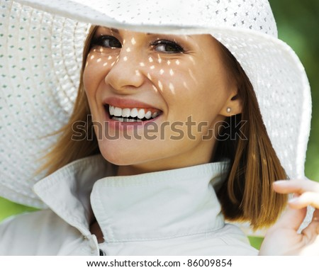 woman with snow-white smile white hat