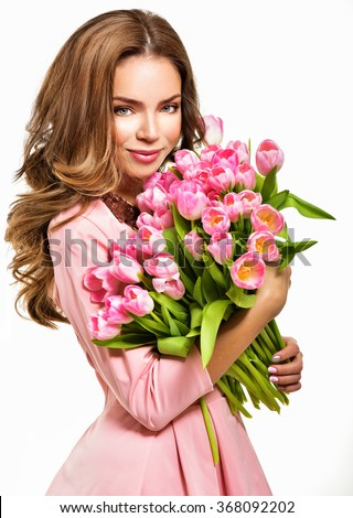 Woman with Spring Flower bouquet. Happy surprised model woman smelling flowers. Mother\'s Day. Springtime