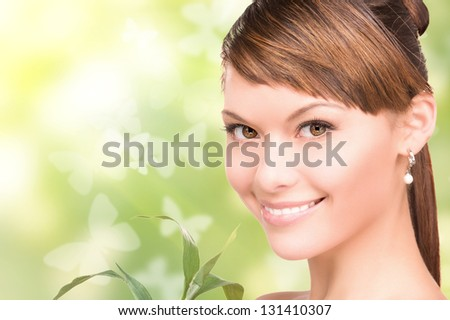 woman with sprout and butterflies over green background - stock photo