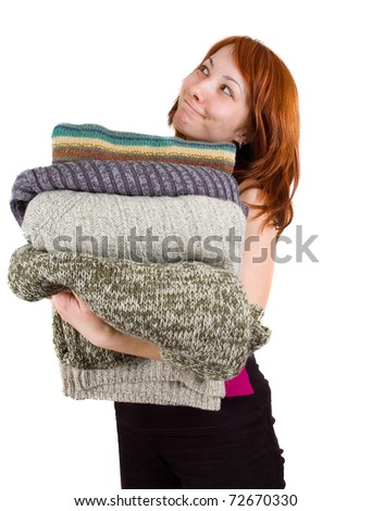 woman with stack of sweaters - stock photo