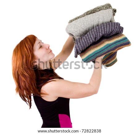 woman with stack of sweaters