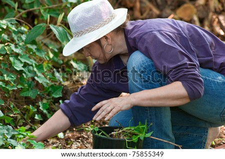 Woman with straw hat gardening
