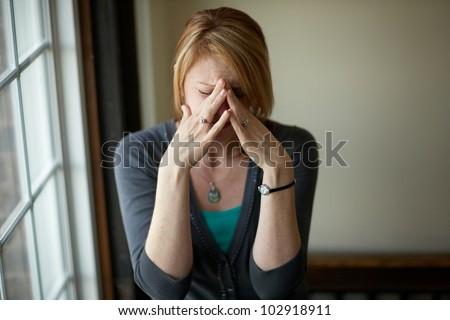 Woman with stress headache problem
