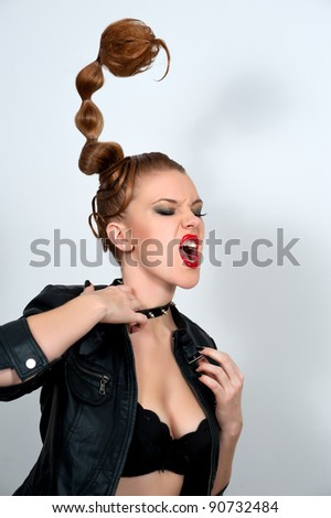 "Woman with stylish creative hairstyle ""scorpion"""