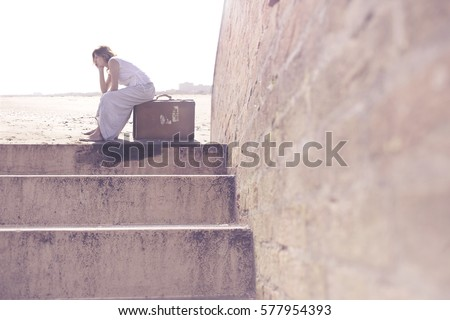 woman with suitcase waiting to leave for a long trip