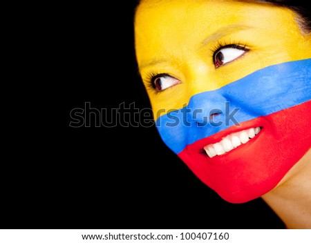 Woman with the flag Colombia painted on her face - isolated over a black background