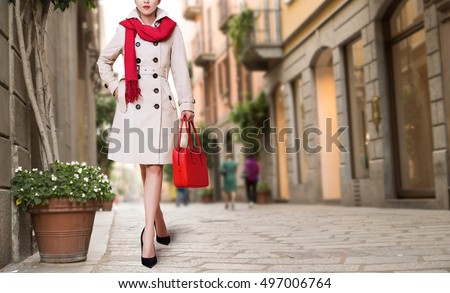 Woman with the trench coat, red scarf and purse in the town Autumn fall winter fashion image. Stock photo ©