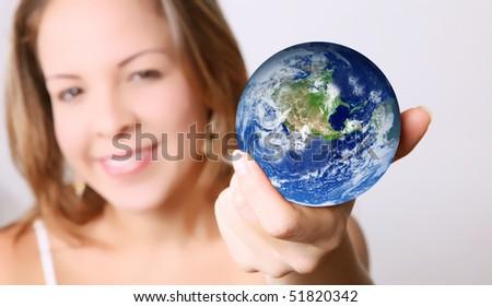 Woman with the world in her hands