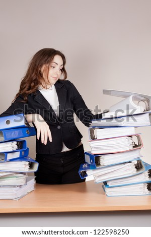 Woman with tons of folders on the table