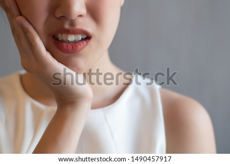 woman with toothache; sick asian woman suffering from toothache, tooth decay, tooth sensitivity, cavity, dental care concept; young adult asian woman model Сток-фото ©