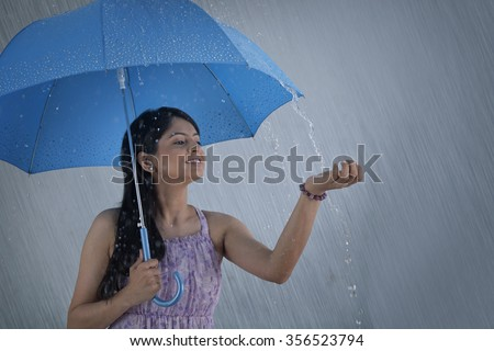 woman with umbrella enjoying...