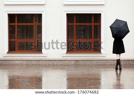 Stock Photo Woman with umbrella in the rain