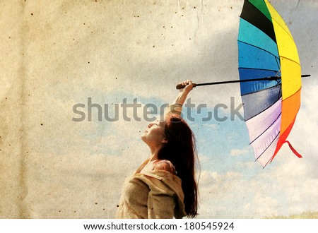 Woman with umbrella. Photo in old color image style.