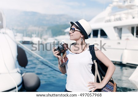 woman with vintage camera at...