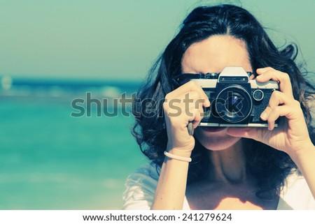 woman with vintage retro camera ...