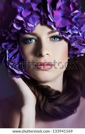 Woman with violet flowers. Woman with braid.