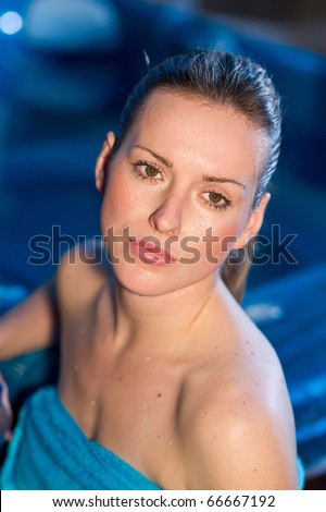 woman with wet face cooling