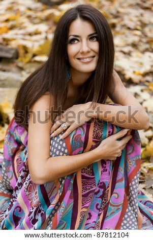 woman with yellow leaves in autumn