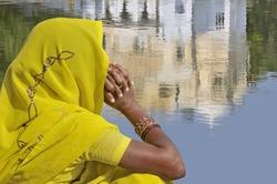 Woman with yellow sari in India.