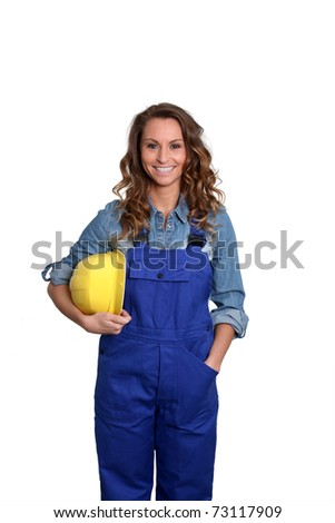 Woman with yellow security helmet standing on white background