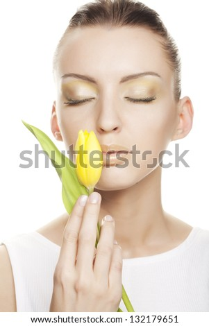 Woman with yellow tulips bouquet of flowers isolated on white background
