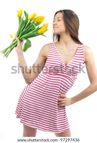 Woman with yellow tulips bouquet of flowers smiling isolated on white background
