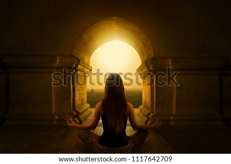 Woman with yoga pose in buddhist temple