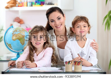 Woman with young children learning about the world - stock photo