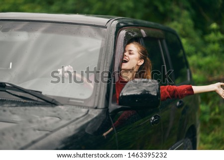 Woman woman driving a car countryside countryside nature vacation rest