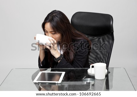 woman worker eating unhealthy food during the office hour.