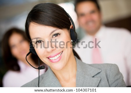 Woman working at a call center and wearing headset