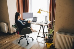 woman working at home. telework on laptop