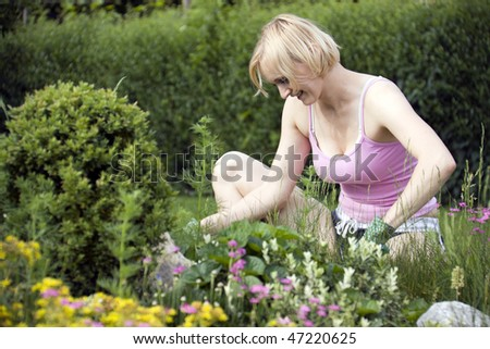 Woman working in the blooming spring garden