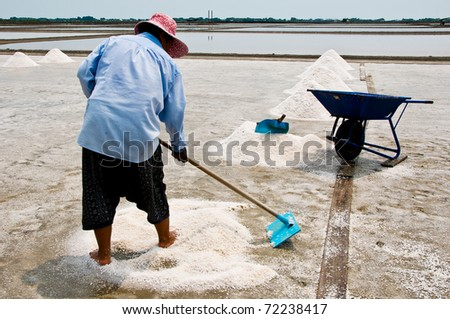 Woman working in the salt field in Thailand