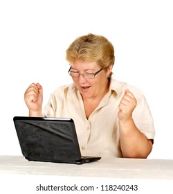stock photo woman is working on laptop. elderly woman is satisfied with their work.