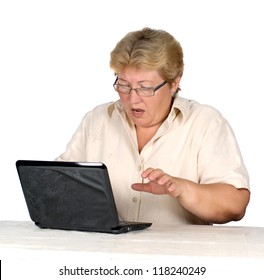 stock photo woman is working on laptop. elderly woman scared the results of use laptop.