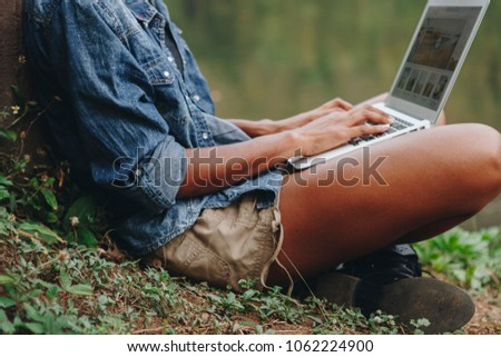 Woman working on a laprop in the nature