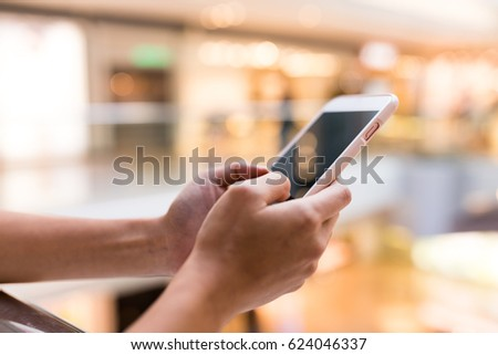 Woman working on cellphone #624046337