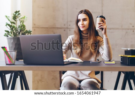 Woman working on laptop. Manager sitting at office desk and performing project using corporate software on PC. Career opportunities for young specialist, enterprise practice, distant online education