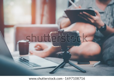 woman working remotely from home on laptop, sitting on the couch in living room in front of the camera.work from home concept.stay at home.
